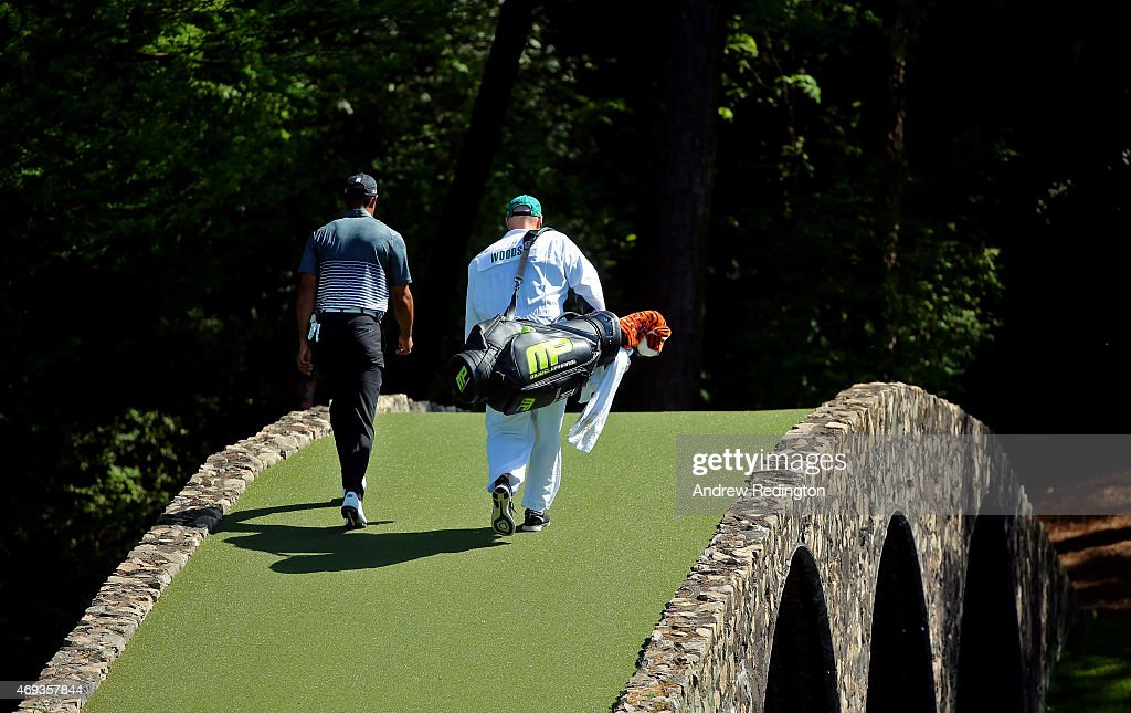 <a gi-track='captionPersonalityLinkClicked' href=/galleries/search?phrase=Tiger+Woods&family=editorial&specificpeople=157537 ng-click='$event.stopPropagation()'>Tiger Woods</a> of the United States walks across the Hogan Bridge with his caddie <a gi-track='captionPersonalityLinkClicked' href=/galleries/search?phrase=Joe+LaCava&family=editorial&specificpeople=695531 ng-click='$event.stopPropagation()'>Joe LaCava</a> during the third round of the 2015 Masters Tournament at Augusta National Golf Club on April 11, 2015 in Augusta, Georgia.