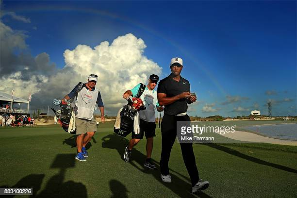 Tiger Woods of the United States walks off of the 18th green during the first round of the Hero World Challenge at Albany Bahamas on November 30 2017...