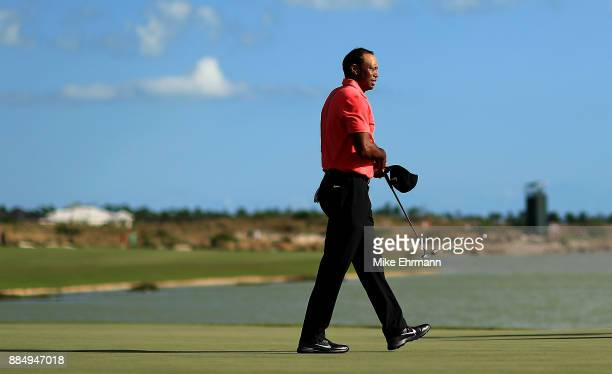 Tiger Woods of the United States walks off the 18th hole during the final round of the Hero World Challenge at Albany Bahamas on December 3 2017 in...