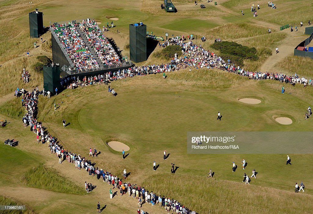 <a gi-track='captionPersonalityLinkClicked' href=/galleries/search?phrase=Tiger+Woods&family=editorial&specificpeople=157537 ng-click='$event.stopPropagation()'>Tiger Woods</a> of the United States walks onto the 10th green during the first round of the 142nd Open Championship at Muirfield on July 18, 2013 in Gullane, Scotland.