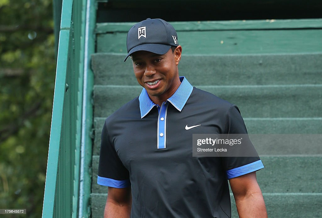 <a gi-track='captionPersonalityLinkClicked' href=/galleries/search?phrase=Tiger+Woods&family=editorial&specificpeople=157537 ng-click='$event.stopPropagation()'>Tiger Woods</a> of the United States walks to the range during a practice round prior to the start of the 95th PGA Championship at Oak Hill Country Club on August 5, 2013 in Rochester, New York.