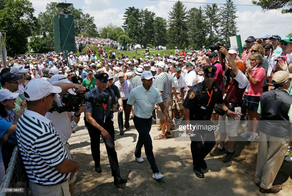 Tiger Woods of the United States walks to the second tee during Round Three of the 113th U.S. Open at Merion Golf Club on June 15, 2013 in Ardmore, Pennsylvania.