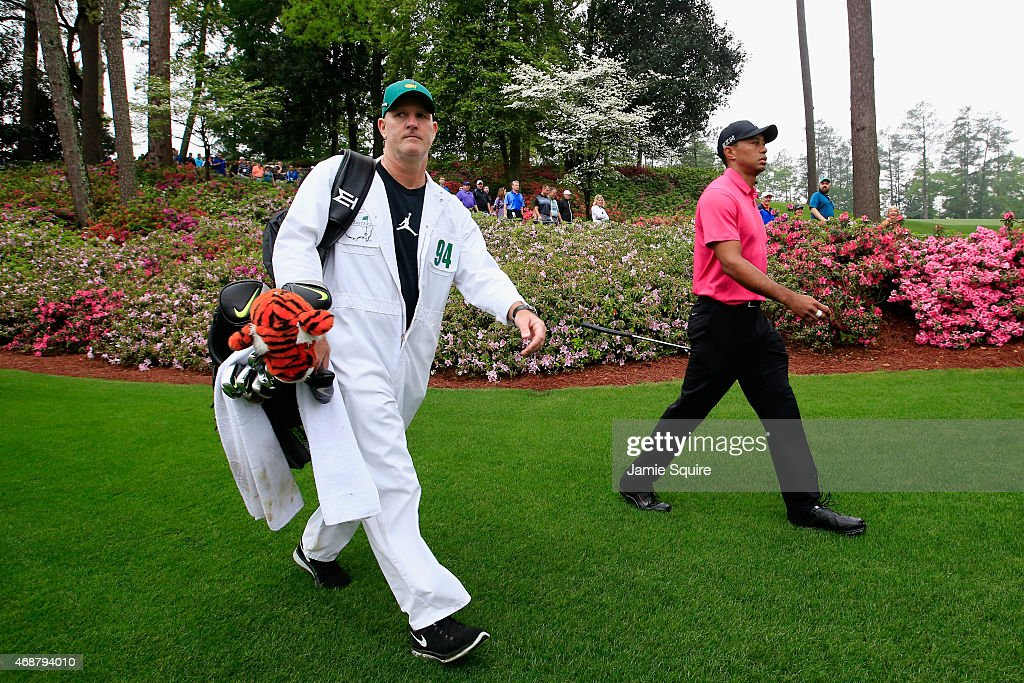 Tiger Woods of the United States walks with his caddie Joe LaCava during a practice round prior to the start of the 2015 Masters Tournament at Augusta National Golf Club on April 7, 2015 in Augusta, Georgia.