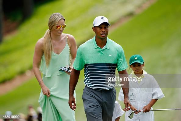 Tiger Woods of the United States walks with his girlfriend Lindsey Vonn and daughter Sam during the Par 3 Contest prior to the start of the 2015...