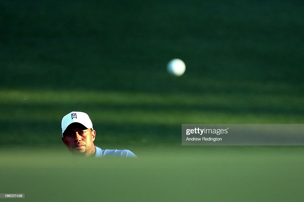 <a gi-track='captionPersonalityLinkClicked' href=/galleries/search?phrase=Tiger+Woods&family=editorial&specificpeople=157537 ng-click='$event.stopPropagation()'>Tiger Woods</a> of the United States watches a shot during a practice round prior to the start of the 2013 Masters Tournament at Augusta National Golf Club on April 10, 2013 in Augusta, Georgia.