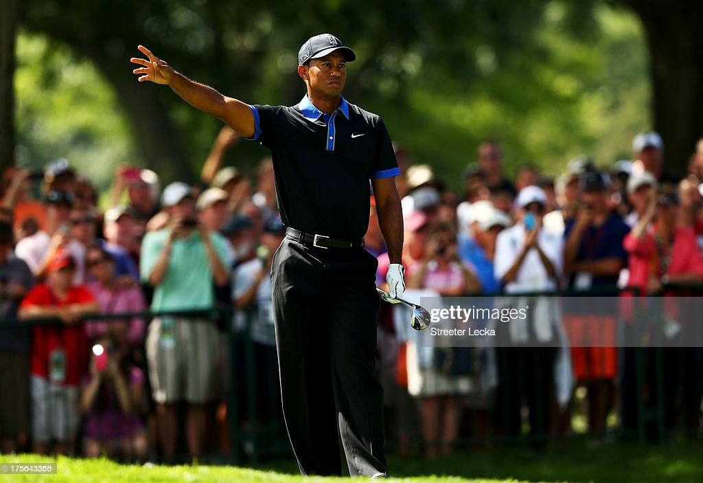 <a gi-track='captionPersonalityLinkClicked' href=/galleries/search?phrase=Tiger+Woods&family=editorial&specificpeople=157537 ng-click='$event.stopPropagation()'>Tiger Woods</a> of the United States watches a shot during a practice round prior to the start of the 95th PGA Championship at Oak Hill Country Club on August 5, 2013 in Rochester, New York.