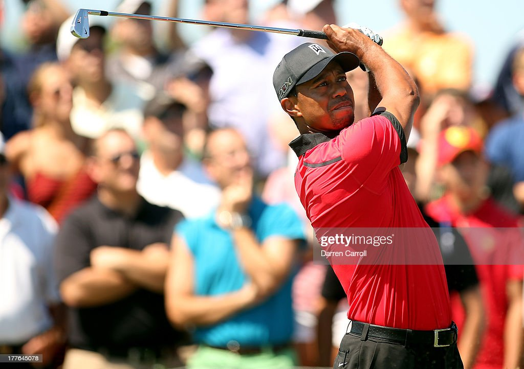 Tiger Woods of the United States watches his tee shot on the second tee during the final round of The Barclays at Liberty National Golf Club on August 25, 2013 in Jersey City, New Jersey.