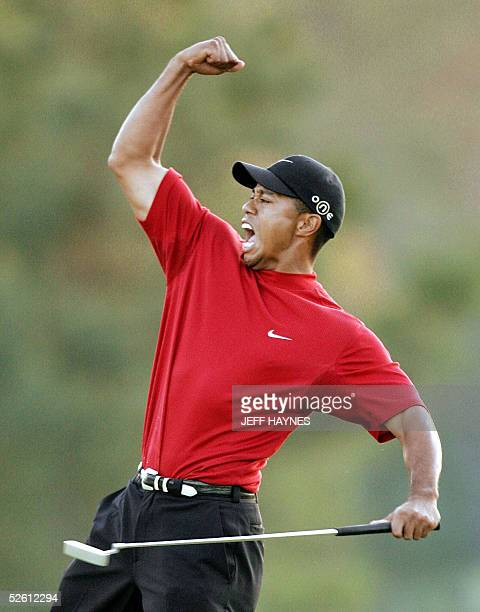 Tiger Woods of the US celebrates winning the 2005 Masters Golf Tournament Championship 10 April 2005 at the Augusta National Golf Club in Augusta Ga...