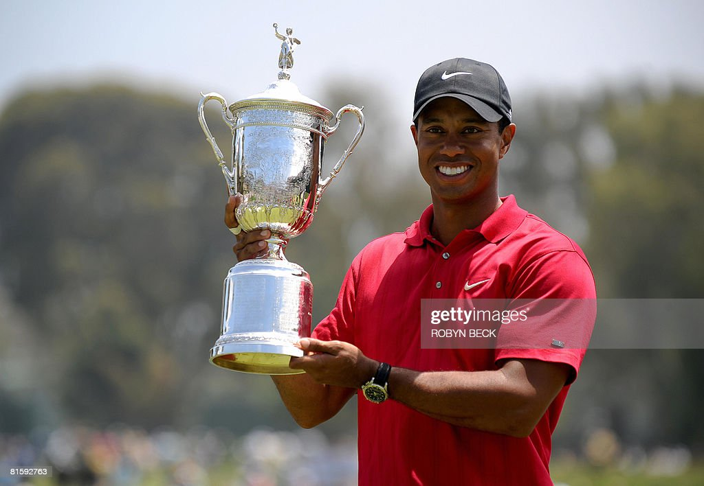 Tiger Woods of the US holds his trophy after defeating compatriot Rocco Mediate in the sudden death playoff at the 108th US Open golf tournament at...