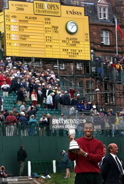 Tiger Woods of the US holds the winner's claret jug trophy on the 18th green of the Old Course at St Andrews after his victory in the British Open...