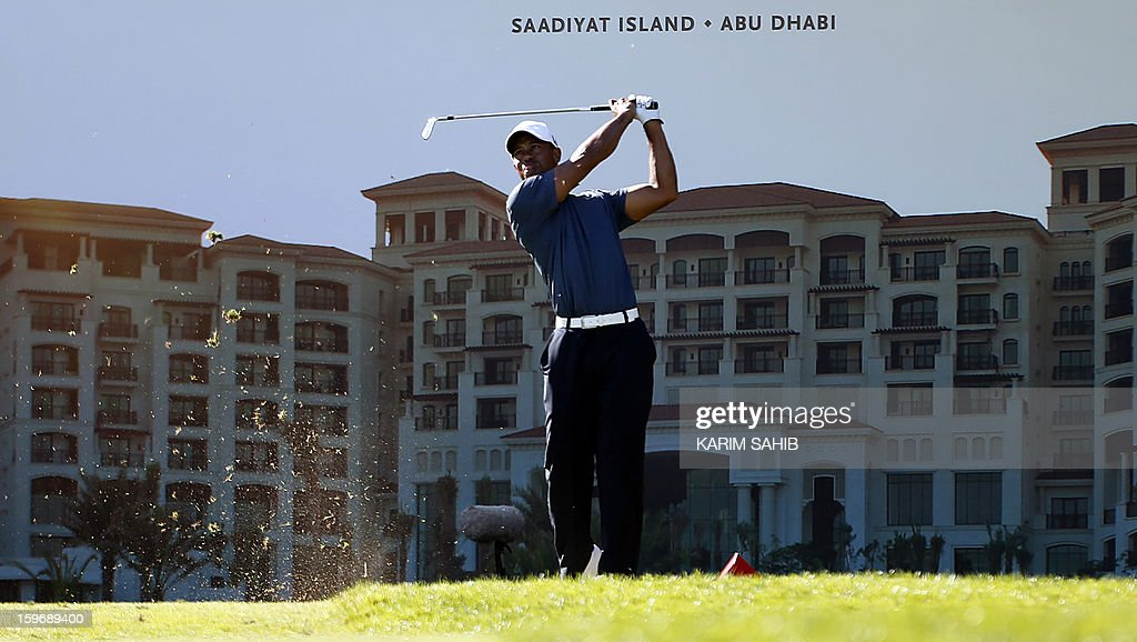 Tiger Woods of the US plays a shot during the second round of the Abu Dhabi Golf Championship at the Abu Dhabi Golf Club in the Emirati capital on January 18, 2013. AFP PHOTO/KARIM SAHIB