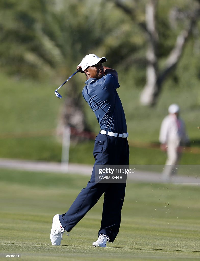 Tiger Woods of the US plays a shot during the second round of the Abu Dhabi Golf Championship at the Abu Dhabi Golf Club in the Emirati capital on January 18, 2013.
