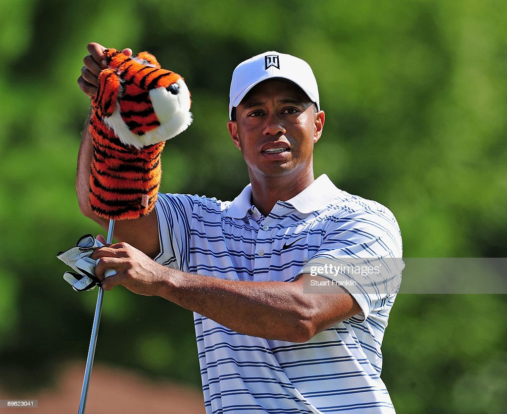Tiger Woods of the U.S. pulls out a club during a practice round of the World Golf Championship Bridgestone Invitational on August 5, 2009 at Firestone Country Club in Akron, Ohio.