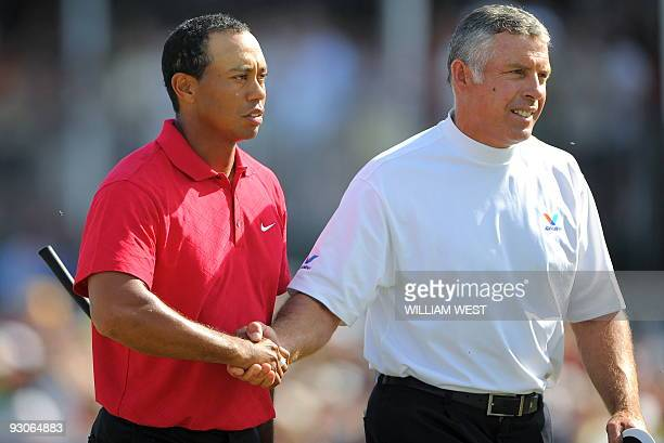 Tiger Woods of the US shakes hands with his caddie Steve Williams after winning the Australian Masters golf tournament during the final round at the...