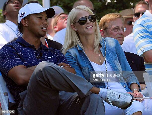 Tiger Woods of the US spekas with his wife Elin during ceremonies on July 1 2009 at the ATT National golf tournament hosted by Tiger Woods at the...