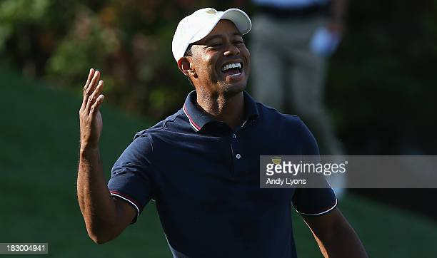 Tiger Woods of the US Team celebrates after winning the 12th hole during the Day One FourBall Matches at the Muirfield Village Golf Club on October 3...