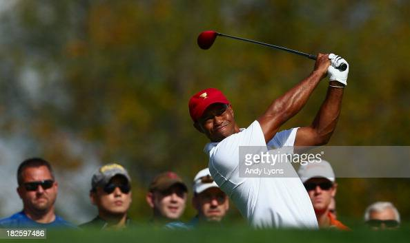 Tiger Woods of the US Team hits a shot during a practice round prior to the start of The Presidents Cup at the Muirfield Village Golf Club on October...