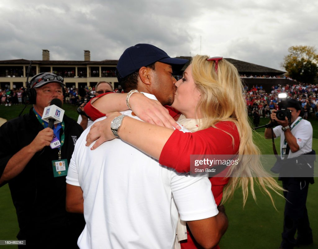Tiger Woods of the U.S. Team is congratulated by Lindsey Vonn after Woods 1up victory over Richard Sterne of the International Team won the Cup for the U.S.Team during the Final Round Singles Matches of The Presidents Cup at the Muirfield Village Golf Club on October 6, 2013 in Dublin, Ohio.