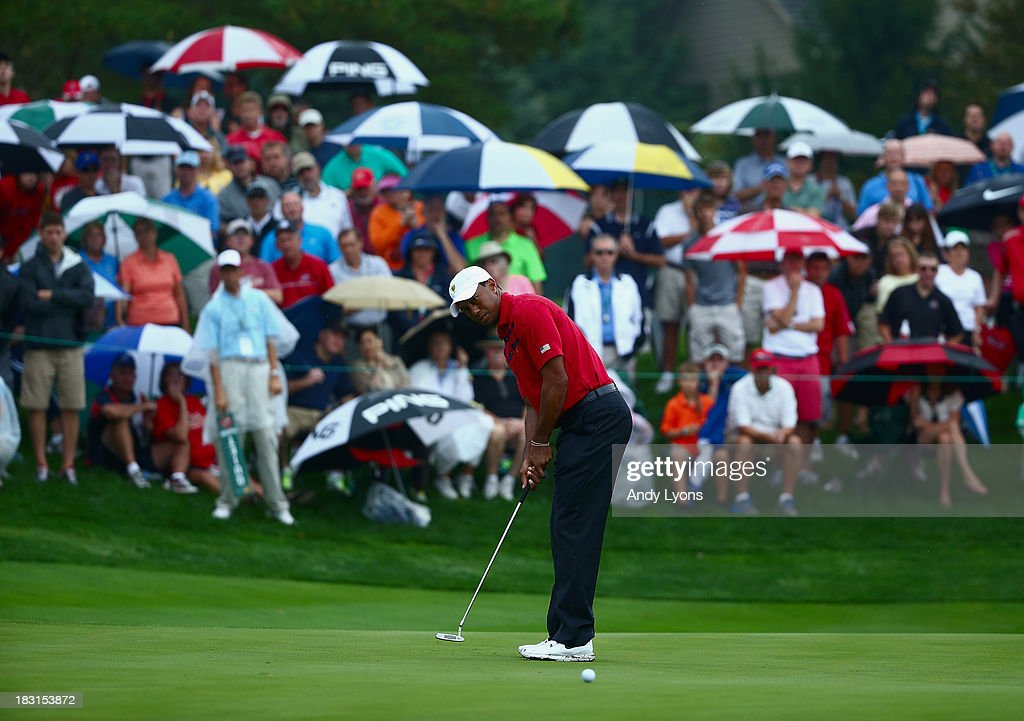 <a gi-track='captionPersonalityLinkClicked' href=/galleries/search?phrase=Tiger+Woods&family=editorial&specificpeople=157537 ng-click='$event.stopPropagation()'>Tiger Woods</a> of the U.S. Team putts for eagle on the fifth green during the Day Three Four-ball Matches at the Muirfield Village Golf Club on October 5, 2013 in Dublin, Ohio.