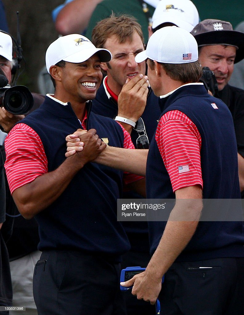 Tiger Woods of the US Team shakes hands with Nick Watney of the US Team after winning his match on the 15th hole during the Day Four Singles Matches...