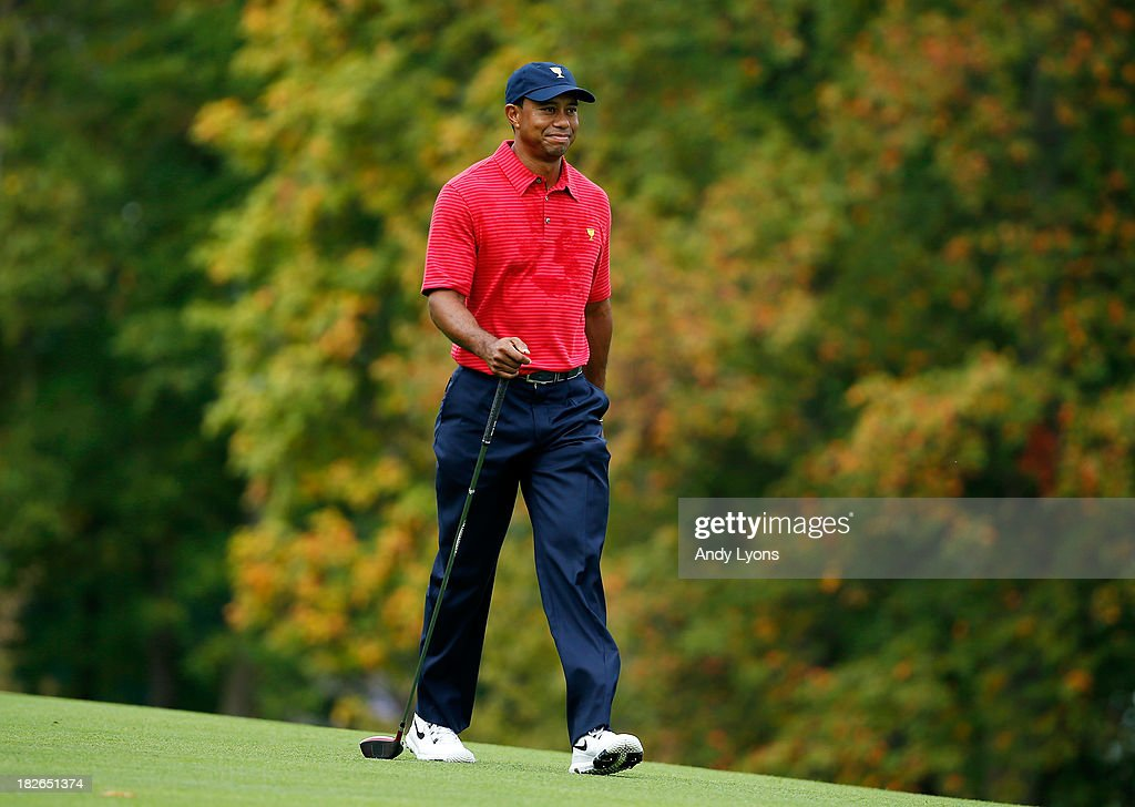 Tiger Woods of the U.S. Team walks down a fairway during a practice round prior to the start of The Presidents Cup at the Muirfield Village Golf Club on October 2, 2013 in Dublin, Ohio.