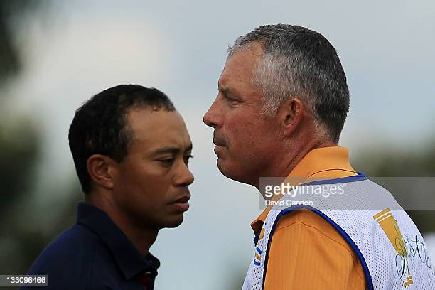 Tiger Woods of the US Team walks past caddie Steve Williams on the 12th hole during the Day One Foursome Matches of the 2011 Presidents Cup at Royal...