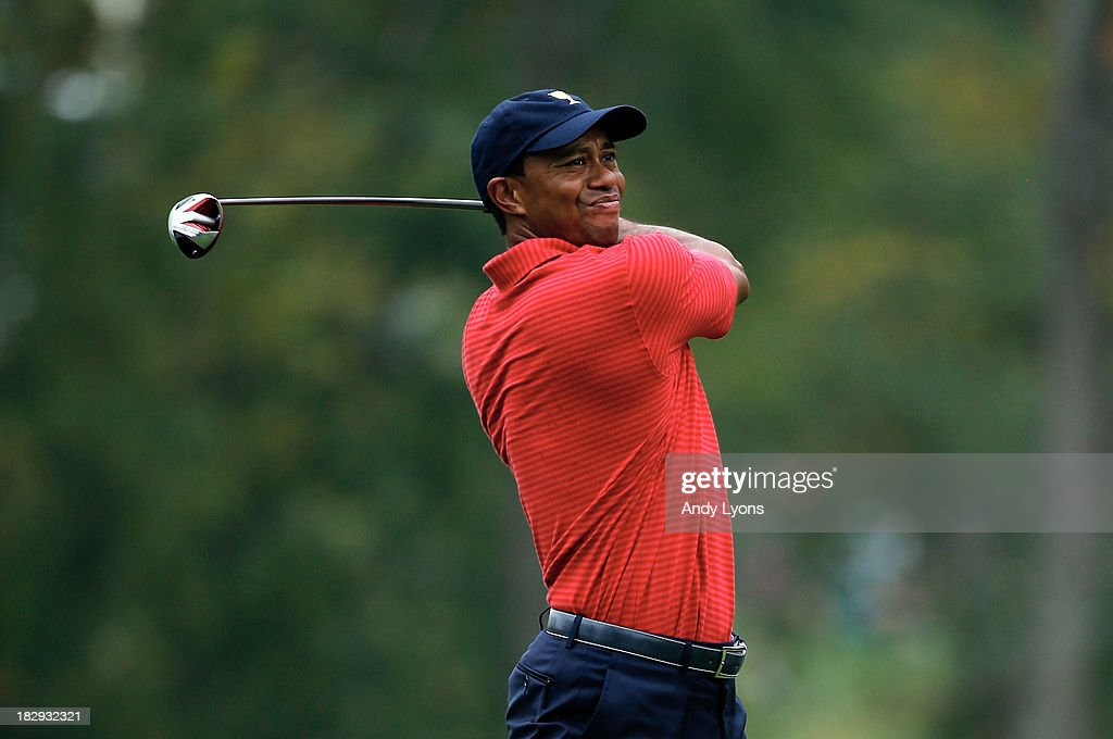 Tiger Woods of the U.S. Team watches a shot during a practice round prior to the start of The Presidents Cup at the Muirfield Village Golf Club on October 2, 2013 in Dublin, Ohio.
