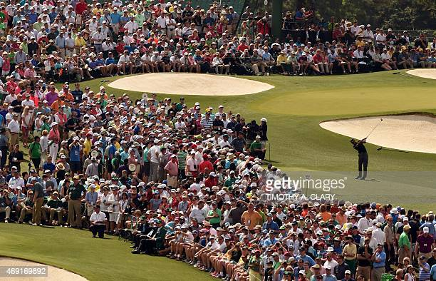 Tiger Woods of the US tees off at the 3rd hole during Round 2 of the 79th Masters Golf Tournament at Augusta National Golf Club on April 10 in...