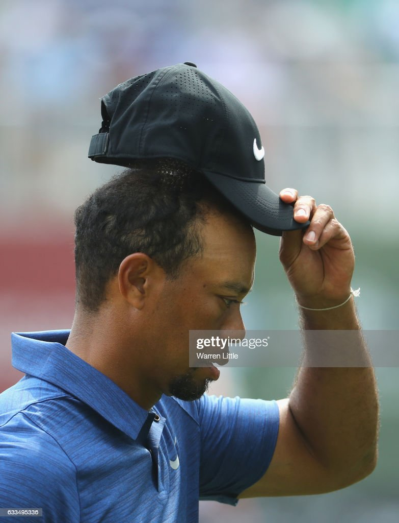 Tiger Woods of the USA acknowledges the crowd on his last hole during the first round of the Omega Dubai Desert Classic at Emirates Golf Club on February 2, 2017 in Dubai, United Arab Emirates.
