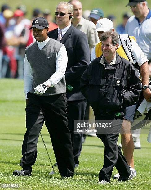 Tiger Woods of the USA and JP McManus walk down the 18th fairway during the first round of the JP McManus Invitational ProAm event on July 4 2005 at...