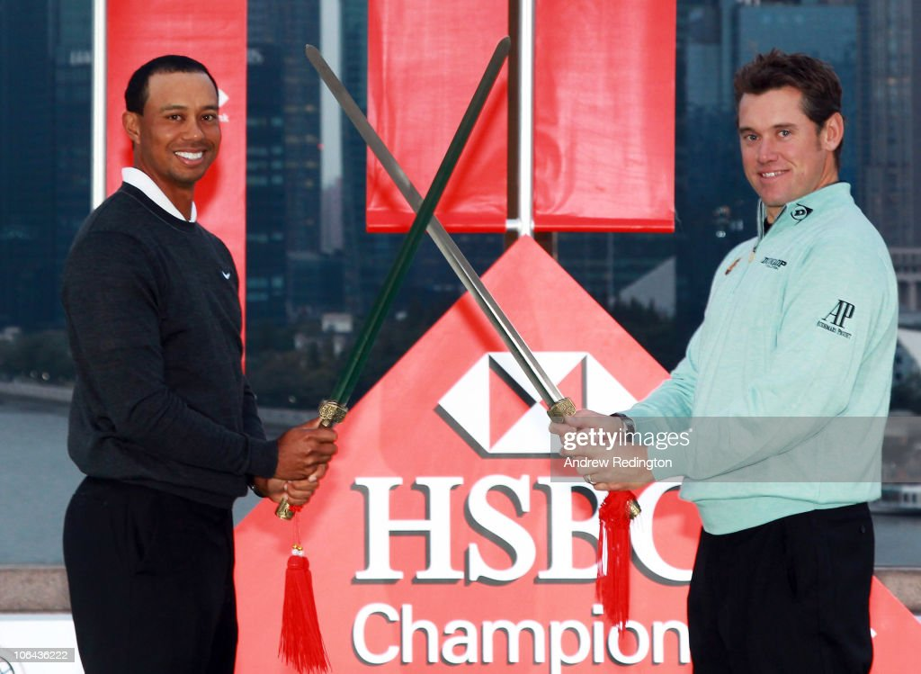 Tiger Woods of the USA and Lee Westwood of England cross swords during the 2010 WGCHSBC Champions Photocall at The Peninsula hotel on The Bund...