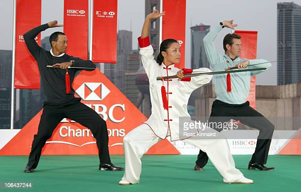 Tiger Woods of the USA and Lee Westwood of England receive a Tai Chi lesson with swords during the 2010 WGCHSBC Champions Photocall at The Peninsula...