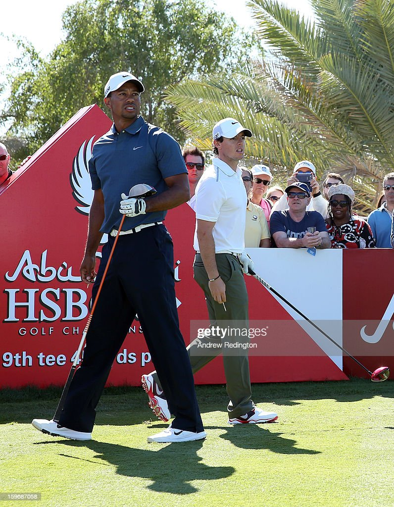 Tiger Woods of the USA (L) and Rory McIlroy of Northern Ireland (R) on the 9th tee during the second round of The Abu Dhabi HSBC Golf Championship at Abu Dhabi Golf Club on January 18, 2013 in Abu Dhabi, United Arab Emirates.
