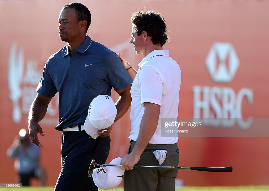 <a gi-track='captionPersonalityLinkClicked' href=/galleries/search?phrase=Tiger+Woods&family=editorial&specificpeople=157537 ng-click='$event.stopPropagation()'>Tiger Woods</a> of the USA and <a gi-track='captionPersonalityLinkClicked' href=/galleries/search?phrase=Rory+McIlroy&family=editorial&specificpeople=783109 ng-click='$event.stopPropagation()'>Rory McIlroy</a> of Northern Ireland on the 18th green during the second round of the Abu Dhabi HSBC Golf Championship at the Abu Dhabi Golf Club on January 18, 2013 in Abu Dhabi, United Arab Emirates.