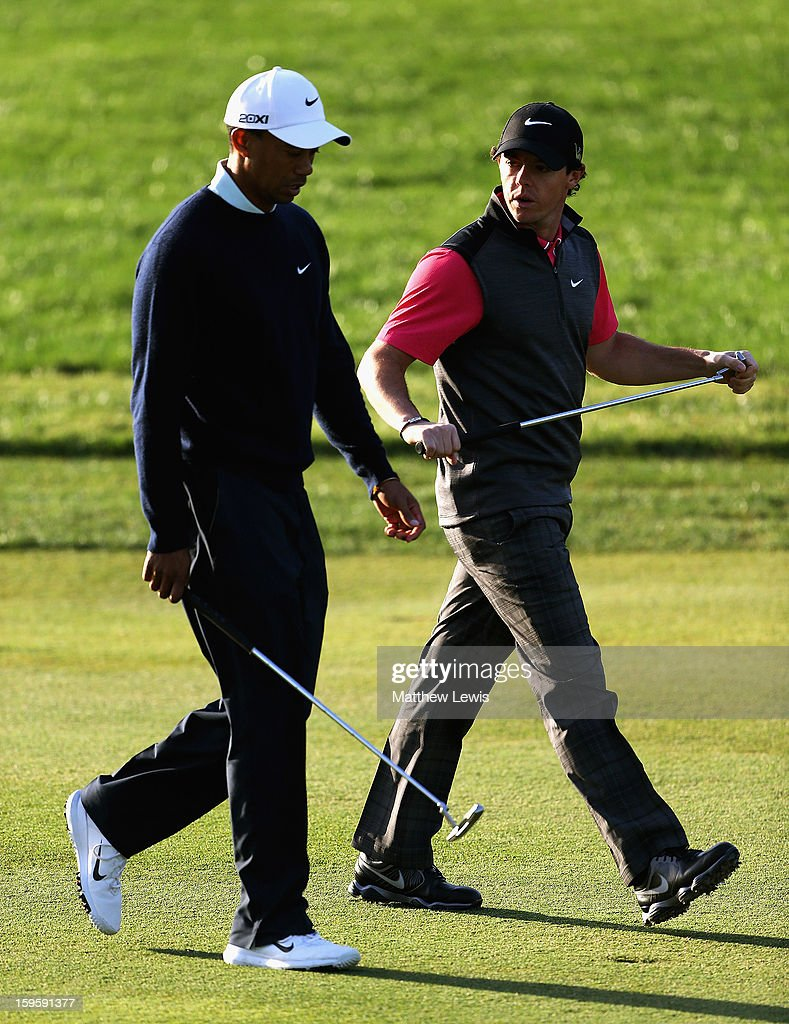 Tiger Woods of the USA and Rory McIlroy of Northern Ireland walk down the 10th fairway during day one of the Abu Dhabi HSBC Golf Championship at Abu Dhabi Golf Club on January 17, 2013 in Abu Dhabi, United Arab Emirates.