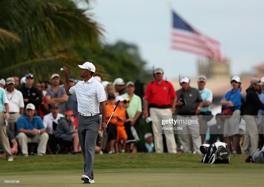 Tiger Woods of the USA catches his ball on the 17th green during the third round of the WGC - Cadillac Championship at the Trump Doral Golf Resort & Spa on March 9, 2013 in Doral, Florida.