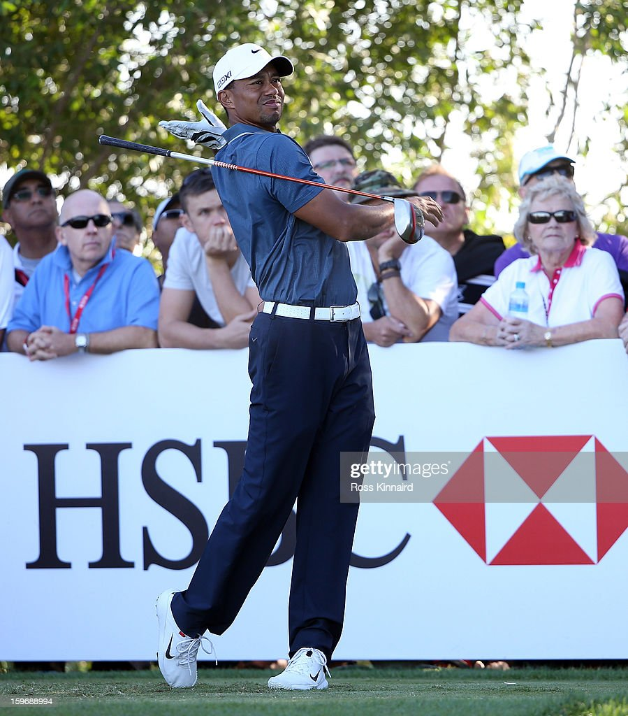 Tiger Woods of the USA drops his club after his tee shot on the 17th tee during the second round of the Abu Dhabi HSBC Golf Championship at the Abu Dhabi Golf Club on January 18, 2013 in Abu Dhabi, United Arab Emirates.