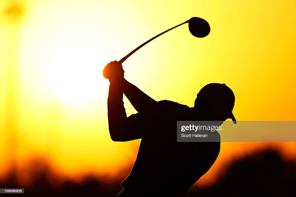 Tiger Woods of the USA hits a shot on the practice ground before the start of the first round of the Abu Dhabi HSBC Golf Championship at Abu Dhabi Golf Club on January 17, 2013 in Abu Dhabi, United Arab Emirates.
