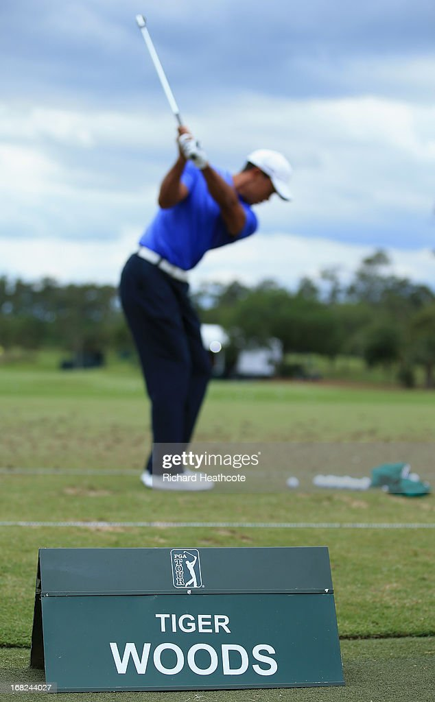 Tiger Woods of the USA hits a shot on the range during a practise round for THE PLAYERS Championship at TPC Sawgrass on May 7, 2013 in Ponte Vedra Beach, Florida.
