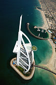 Tiger Woods of the USA hits balls from the helipad on top of the Burj Al Arab Hotel before the 2004 Dubai Desert Classic played at the Emirates Golf...
