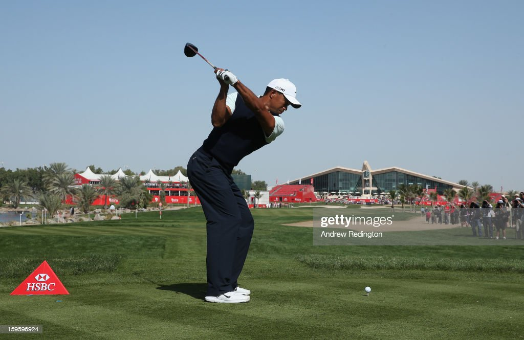 Tiger Woods of the USA hits his tee-shot on the ninth hole during the first round of The Abu Dhabi HSBC Golf Championship at Abu Dhabi Golf Club on January 17, 2013 in Abu Dhabi, United Arab Emirates.