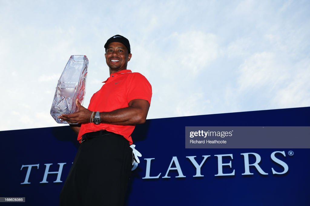 <a gi-track='captionPersonalityLinkClicked' href=/galleries/search?phrase=Tiger+Woods&family=editorial&specificpeople=157537 ng-click='$event.stopPropagation()'>Tiger Woods</a> of the USA holds the winner's trophy after the final round of THE PLAYERS Championship at THE PLAYERS Stadium course at TPC Sawgrass on May 12, 2013 in Ponte Vedra Beach, Florida.