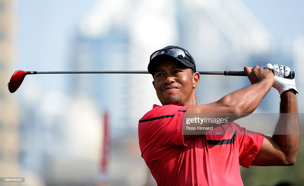 <a gi-track='captionPersonalityLinkClicked' href=/galleries/search?phrase=Tiger+Woods&family=editorial&specificpeople=157537 ng-click='$event.stopPropagation()'>Tiger Woods</a> of the USA in action during the final round of the Omega Dubai Desert Classic on the Majlis Course at the Emirates Golf Club on February 2, 2014 in Dubai, United Arab Emirates.