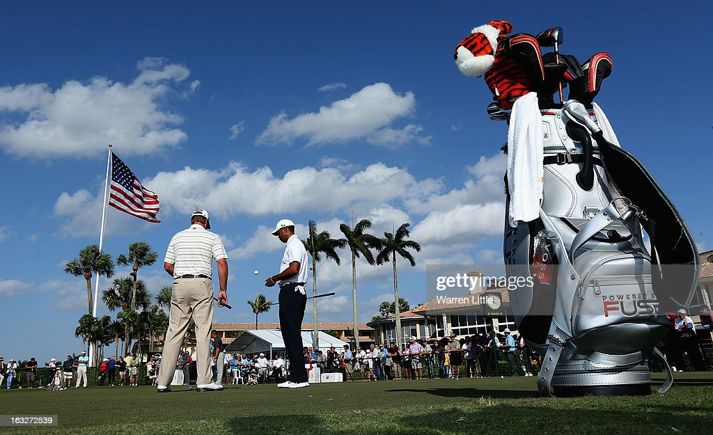 <a gi-track='captionPersonalityLinkClicked' href=/galleries/search?phrase=Tiger+Woods&family=editorial&specificpeople=157537 ng-click='$event.stopPropagation()'>Tiger Woods</a> of the USA is pictured on the practice putting green ahead of the WGC - Cadillac Championship at the Doral Golf Resort & Spa on March 6, 2013 in Miami, Florida.