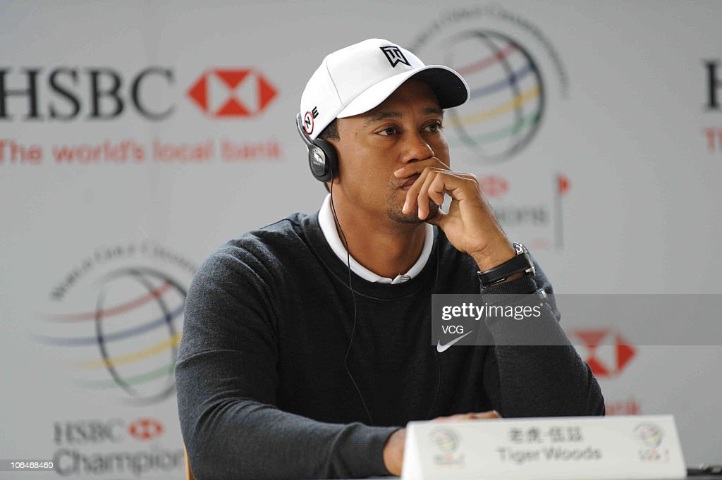 <a gi-track='captionPersonalityLinkClicked' href=/galleries/search?phrase=Tiger+Woods&family=editorial&specificpeople=157537 ng-click='$event.stopPropagation()'>Tiger Woods</a> of the USA listens to a question during a press conference prior to the start of the WGC-HSBC Champions at Sheshan International Golf Club on November 3, 2010 in Shanghai, China.
