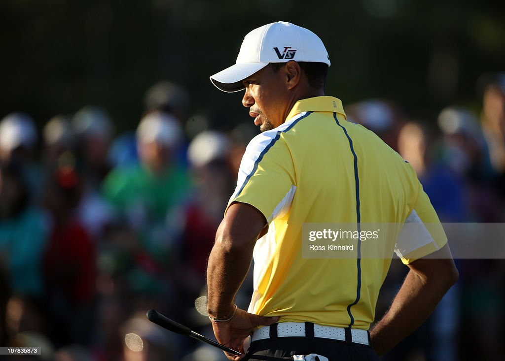 <a gi-track='captionPersonalityLinkClicked' href=/galleries/search?phrase=Tiger+Woods&family=editorial&specificpeople=157537 ng-click='$event.stopPropagation()'>Tiger Woods</a> of the USA on the 18th green during the second round of the 2013 Masters at the Augusta National Golf Club on April 12, 2013 in Augusta, Georgia.