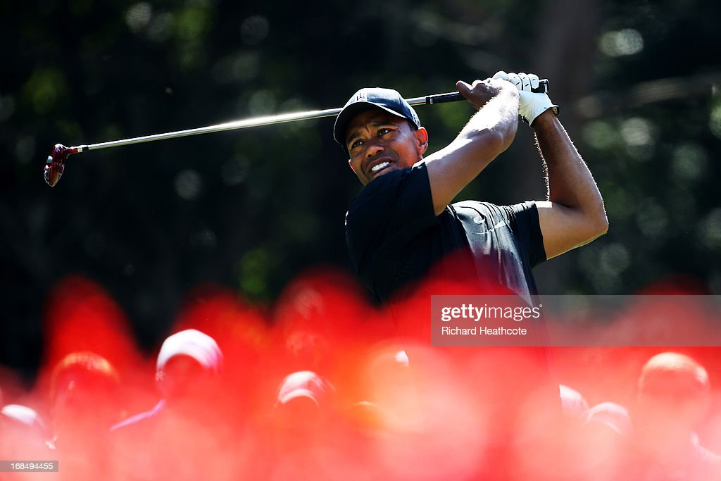 <a gi-track='captionPersonalityLinkClicked' href=/galleries/search?phrase=Tiger+Woods&family=editorial&specificpeople=157537 ng-click='$event.stopPropagation()'>Tiger Woods</a> of the USA plays a shot from the 15th tee during round two of THE PLAYERS Championship at THE PLAYERS Stadium course at TPC Sawgrass on May 10, 2013 in Ponte Vedra Beach, Florida.