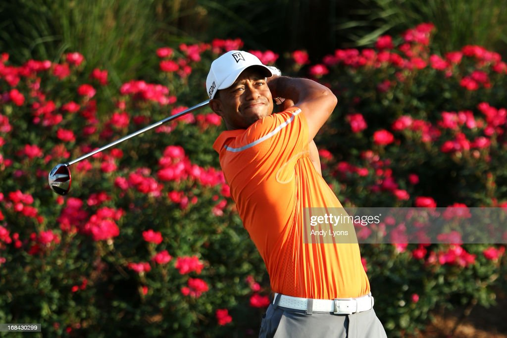 <a gi-track='captionPersonalityLinkClicked' href=/galleries/search?phrase=Tiger+Woods&family=editorial&specificpeople=157537 ng-click='$event.stopPropagation()'>Tiger Woods</a> of the USA plays a shot from the 18th tee during round one of THE PLAYERS Championship at THE PLAYERS Stadium course at TPC Sawgrass on May 9, 2013 in Ponte Vedra Beach, Florida.