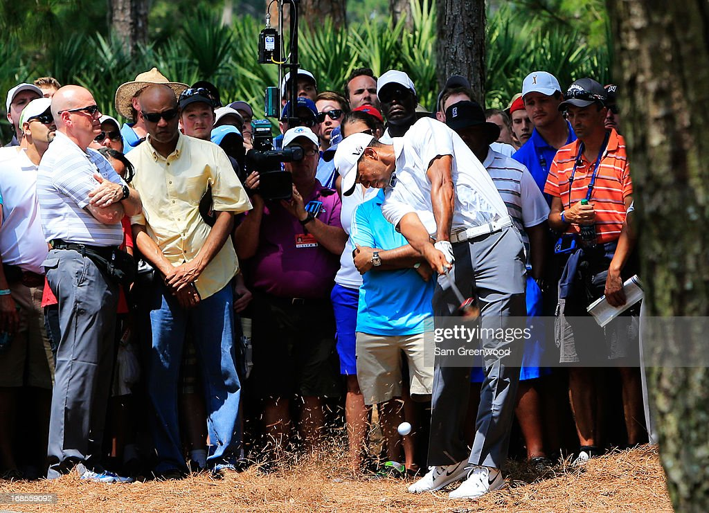 Tiger Woods of the USA plays a shot on the second hole during round three of THE PLAYERS Championship at THE PLAYERS Stadium course at TPC Sawgrass on May 11, 2013 in Ponte Vedra Beach, Florida.