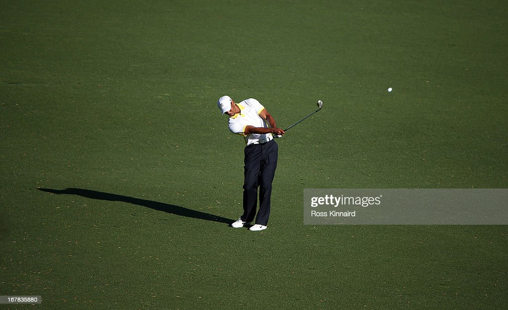Tiger Woods of the USA plays his fith shot on the par five 15th hole after taking a penalty sot during the second round of the 2013 Masters at the Augusta National Golf Club on April 12, 2013 in Augusta, Georgia.
